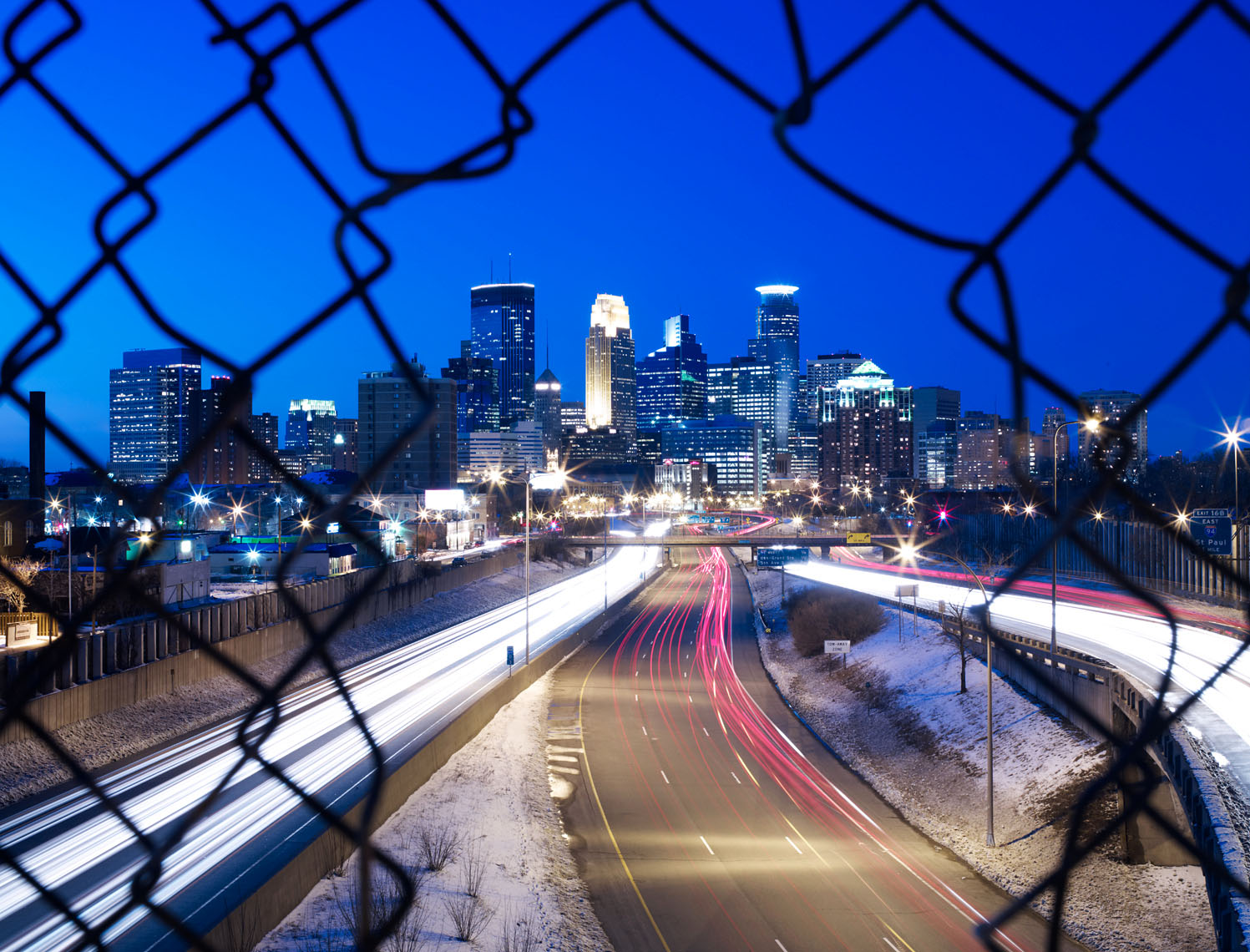 Minneapolis skyline from highway at night winter landscape