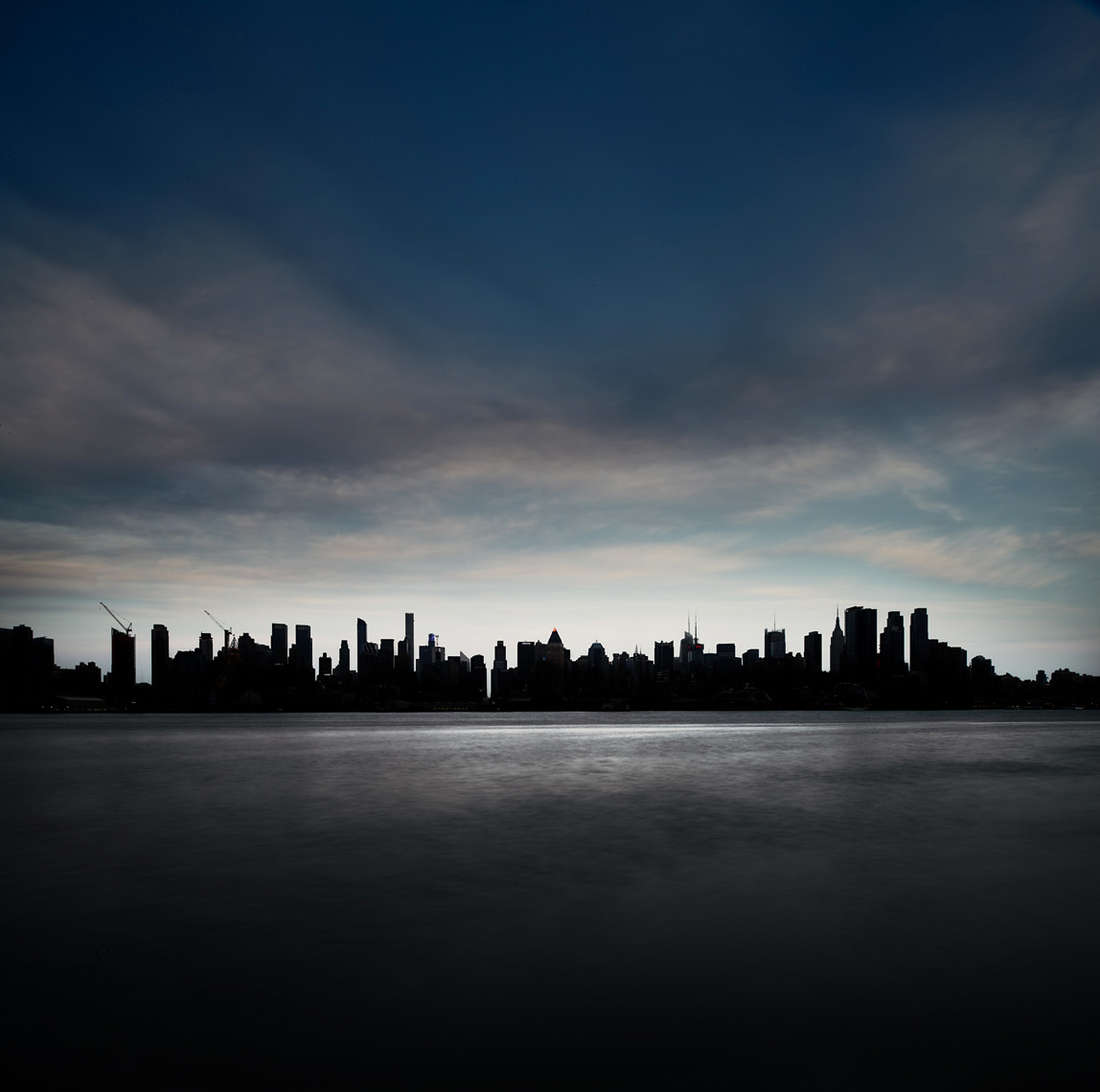 Manhattan skyline and water at dusk landscape
