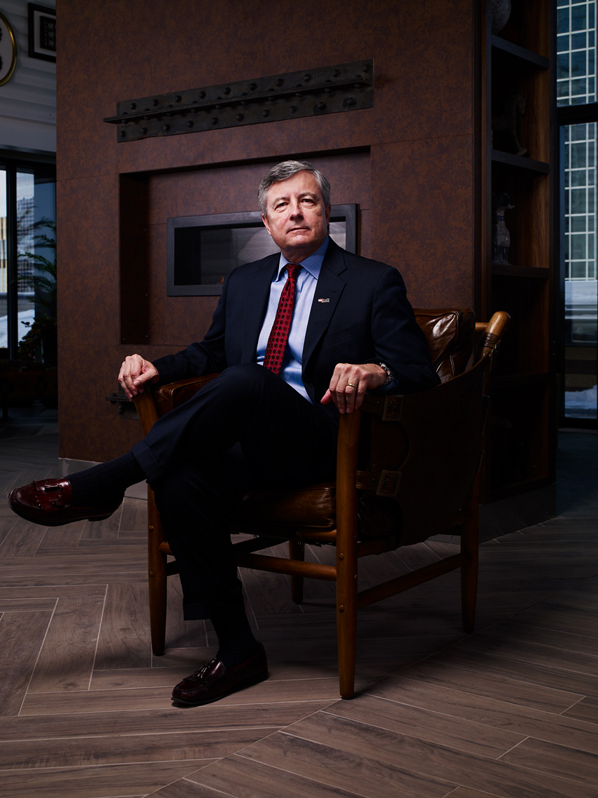 banker sitting in chair corporate portrait