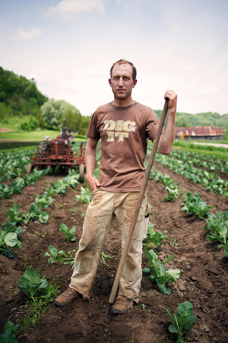 organic farmer working in field portrait agriculture