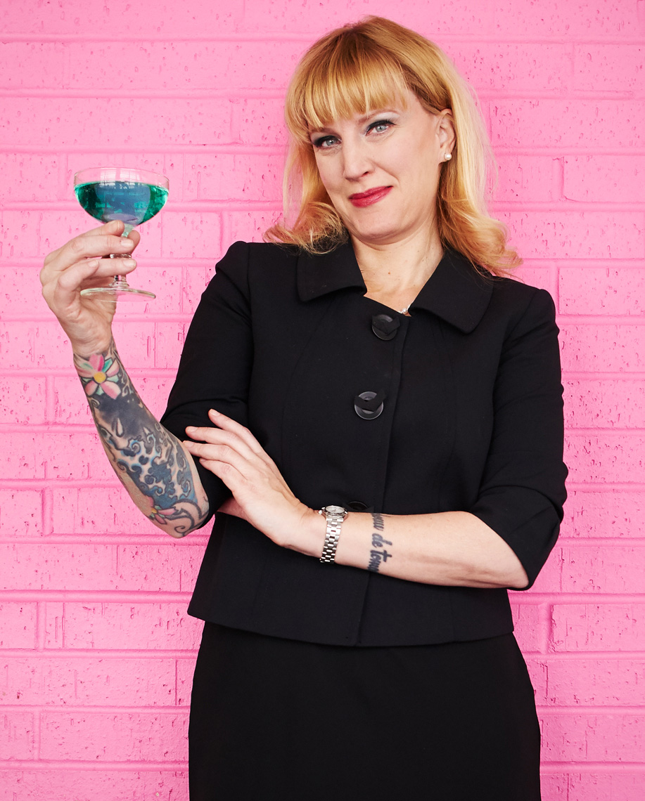 Leslie Bock holds blue coctail drink lifestyle