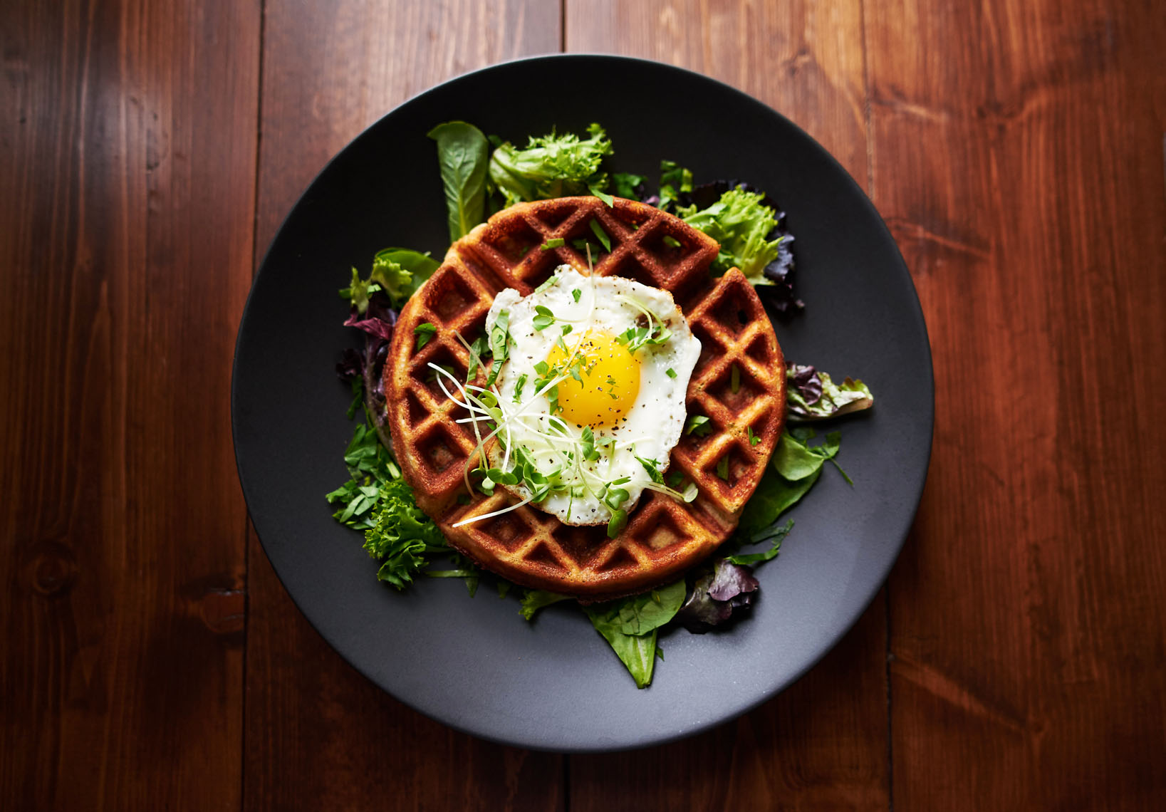 fried egg on waffle breakfast food photography