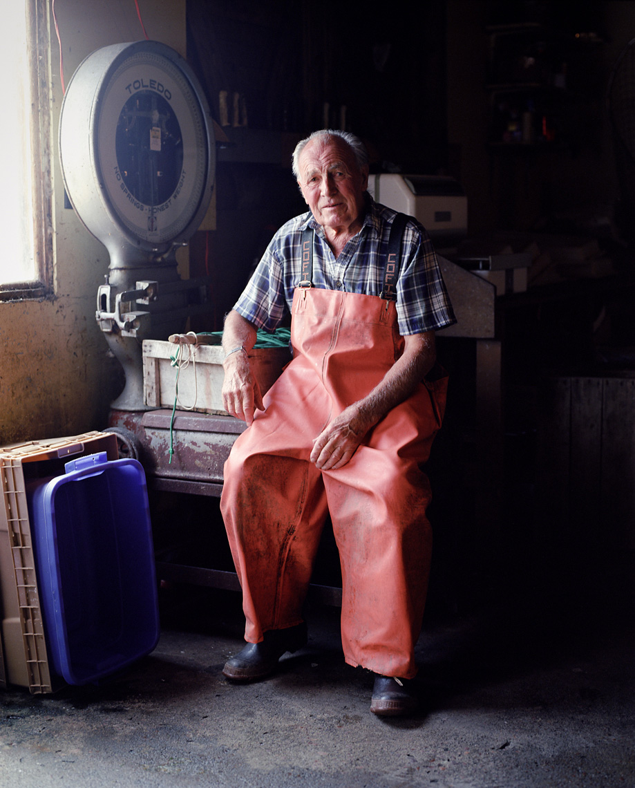 Commercial fisherman Tom Eckel in fish house portrait