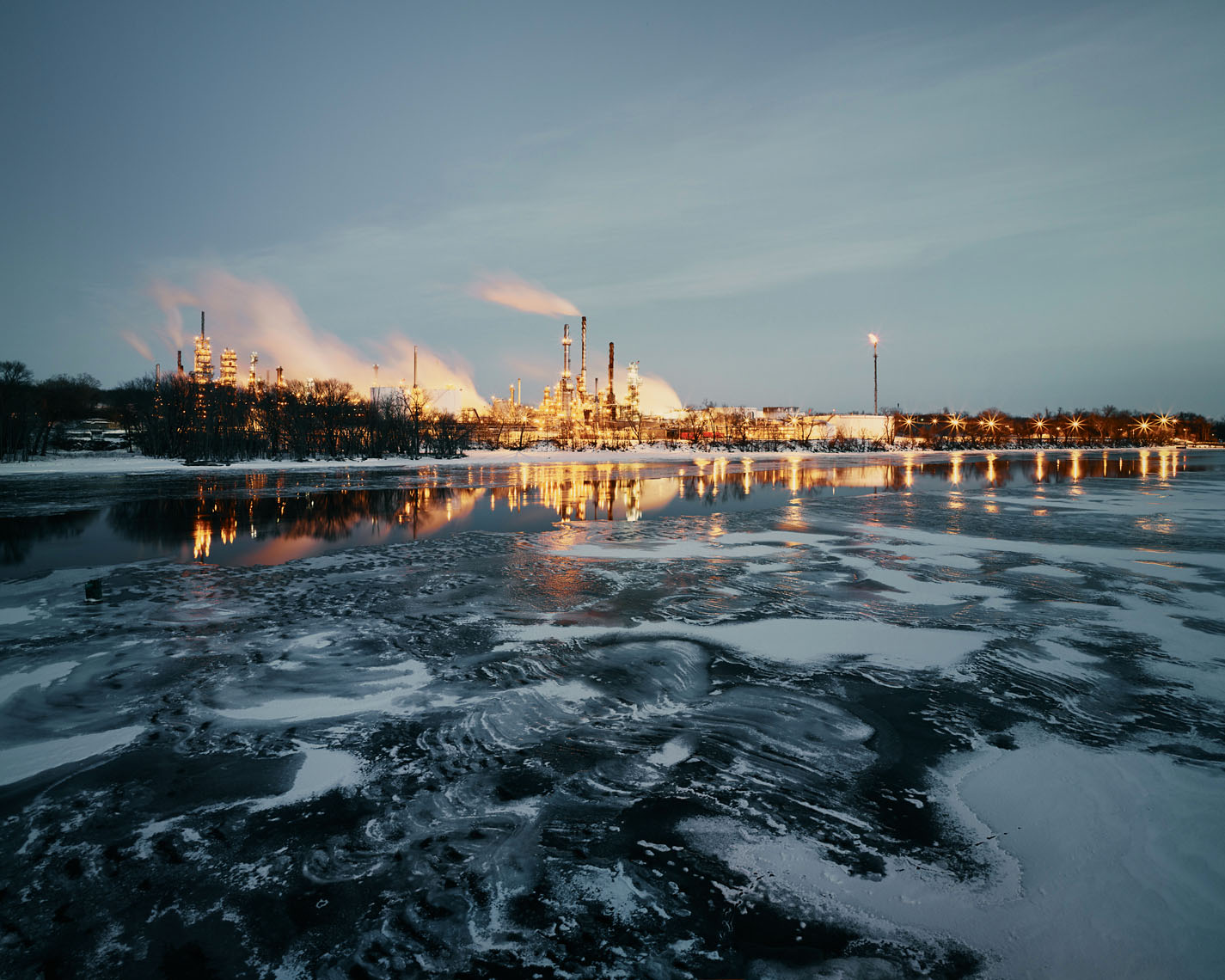 Oil refinery on the frozen Mississippi River industrial