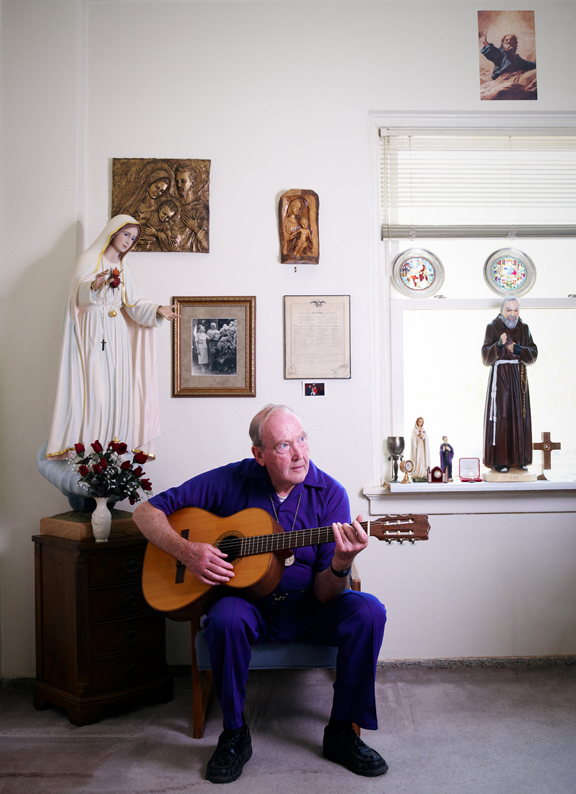 Catholic Priest plays guitar with crying statue portrait