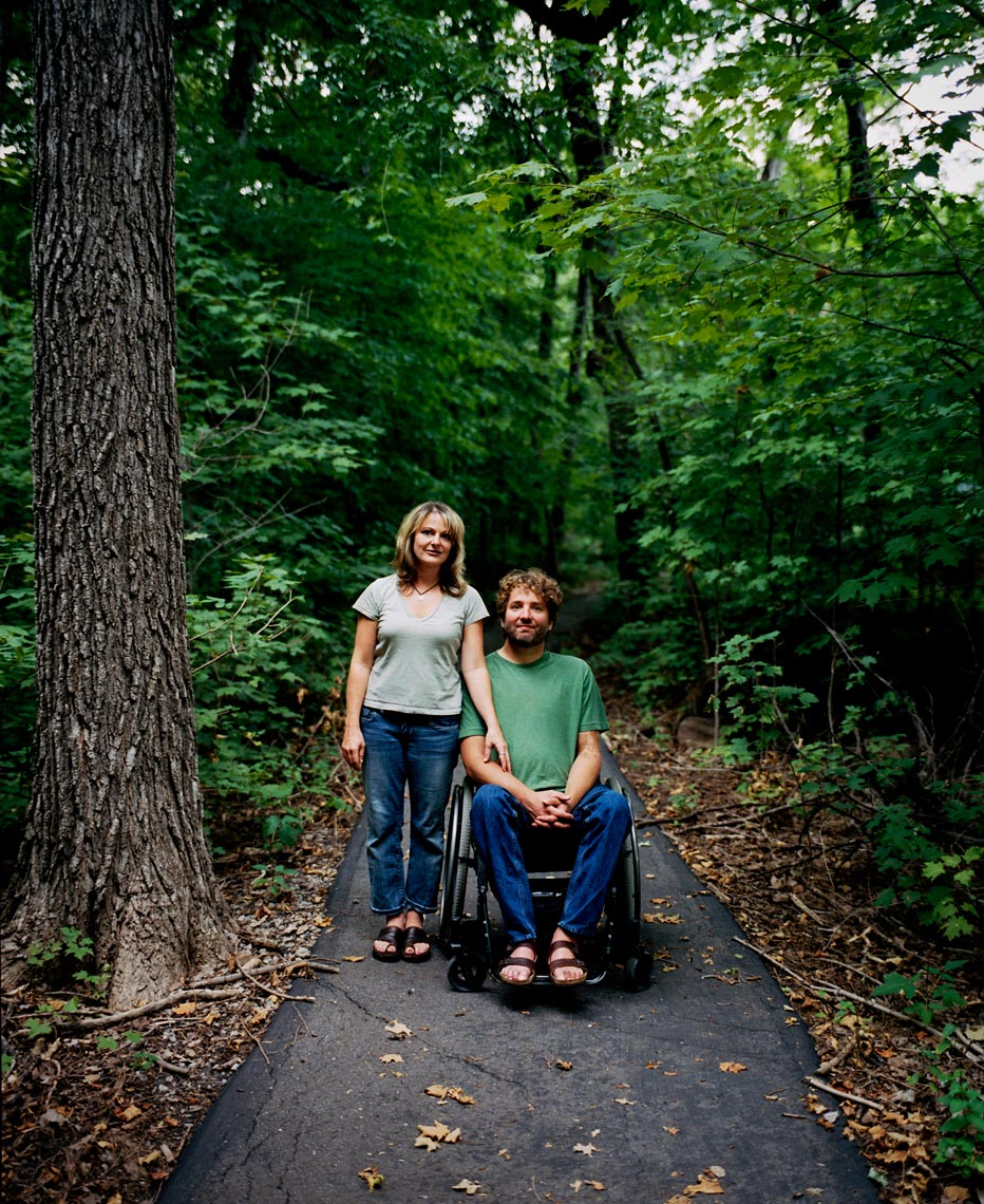 Couple with wheelchair outside on path portrait