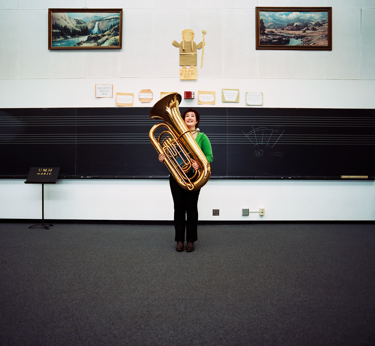 College student with tuba in music room lifestyle
