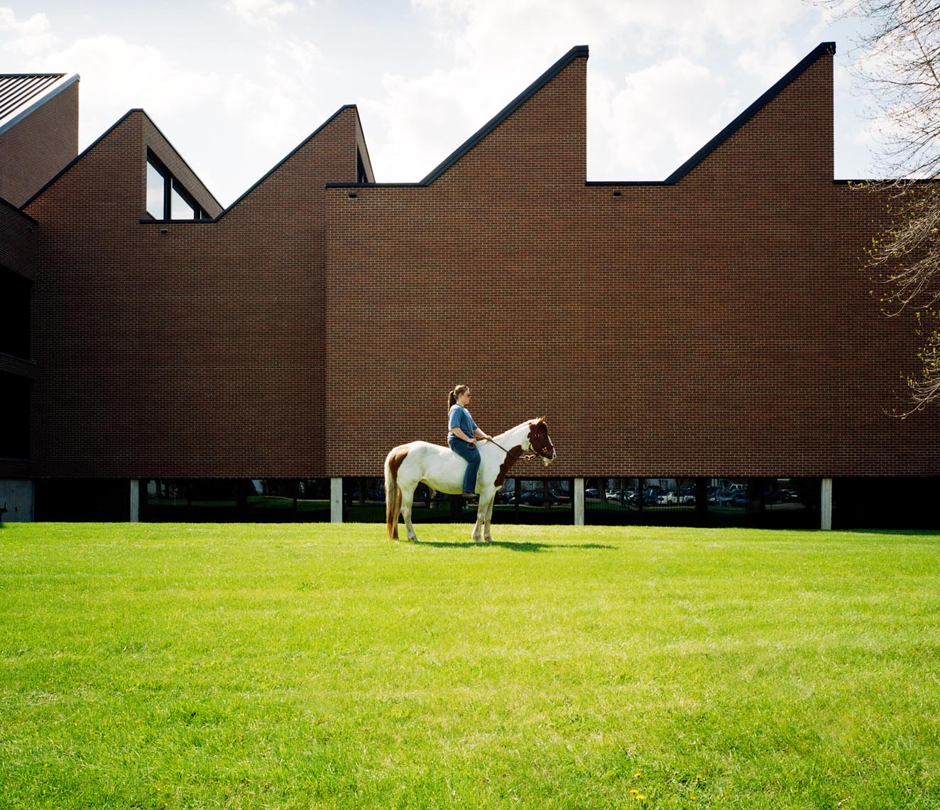 College student with horse on campus portrait